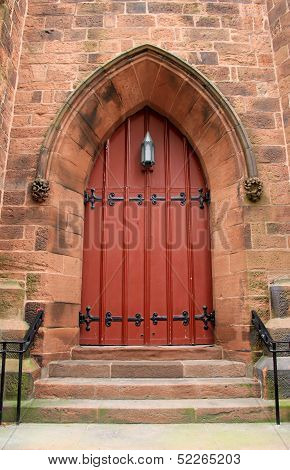 Big red door in old brick church