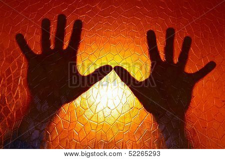 Hands Silhouette on Fire Orange Color Background stained glass with geometric pattern