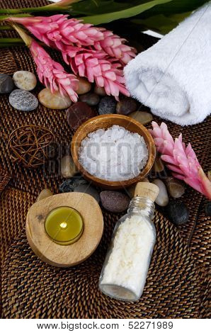 Spa supplies - ginger flower, towel, candle, salt in bowl, zen stones