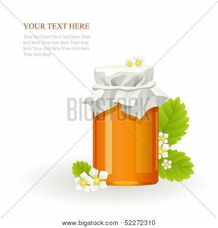 Honey in glass jar and flowers
