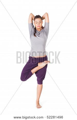 Young Woman Doing Yoga Asana Tree-pose Isolated On White