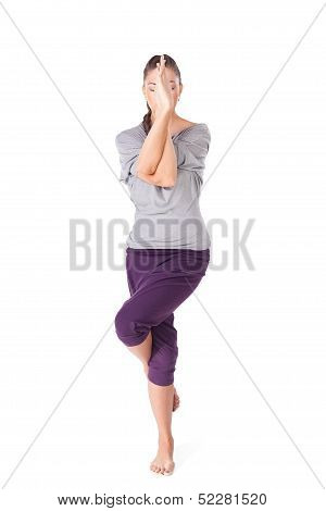 Young Woman Doing Yoga Exercise Garudasana Eagle Pose Isolated On White