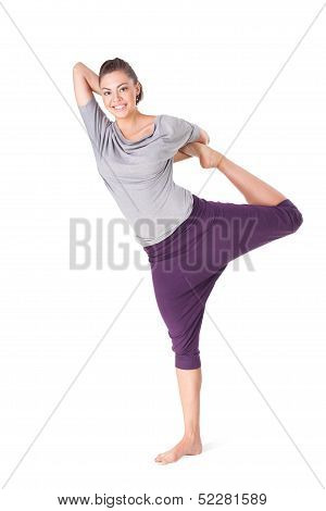 Young Woman Doing Yoga Exercise Natarajasana (lord Of The Dance Pose)
