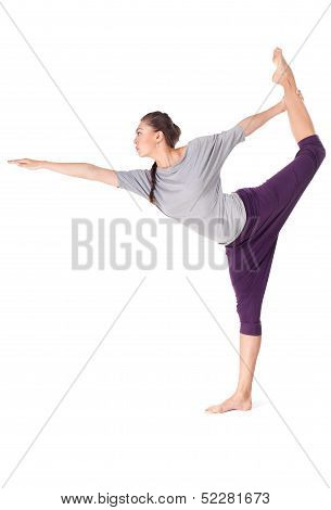 Young Woman Doing Yoga Exercise Lord Of The Dance Pose