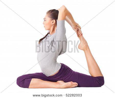 Young Woman Doing Yoga Asana One Legged King Pigeon