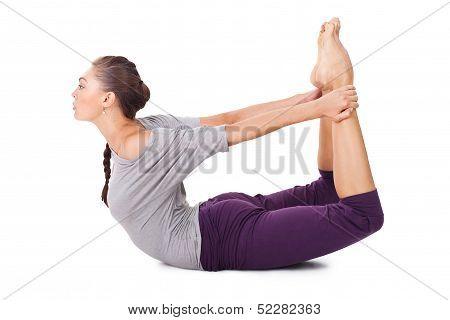 Young Woman Doing Yoga Exercise Dhanurasana (bow Pose)