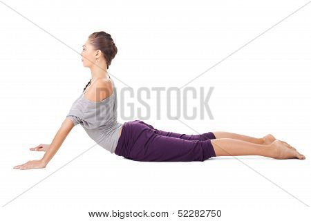 Young Woman Doing Yoga Exercise Bhujangasana (cobra Pose)