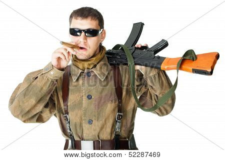 Soldier Wearing Sunglasses With Machine Gun Smoking A Cigar
