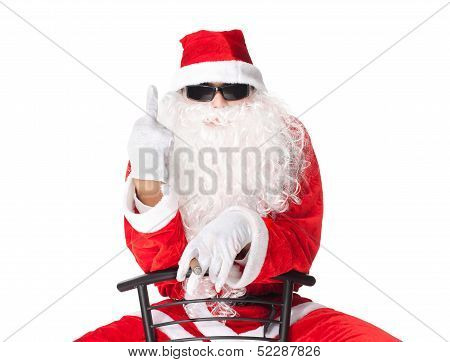 Santa Claus Showing The Middle Finger Sitting In A Chai