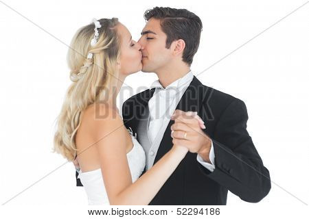 Young married couple dancing viennese waltz kissing each other on white background