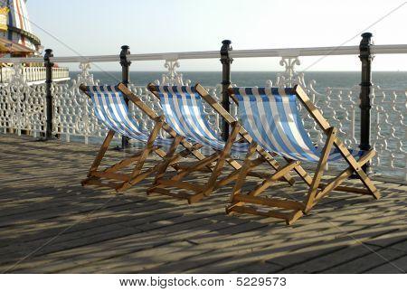 Deckchairs On Pier