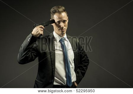 exasperated business man holding a gun to his head
