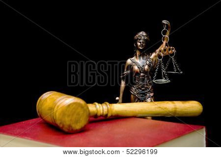 Statue Of Justice On A Black Background.