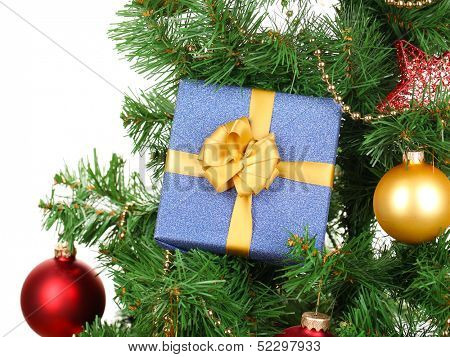 Gift on Christmas tree isolated on white