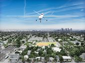 stock photo of drone  - Surveillance UAV drone flying over a residential neighborhood  - JPG