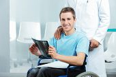 Disabled Young Man At Doctor Office