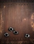 foto of bullet  - old metal background with bullet holes - JPG