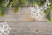 stock photo of fir  - Christmas fir tree and decor covered with snow on wooden board background - JPG