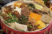 stock photo of stew  - Traditional Ethiopian Food Several types of stew and meat served on Injera