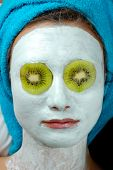 foto of mud pack  - blue thermal mud face pack on woman face - JPG