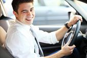 picture of eye-wink  - Man in car winking eye - JPG