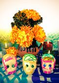stock photo of altar  - Traditional Mexican Day of the dead altar with sugar skulls flowers and candles - JPG
