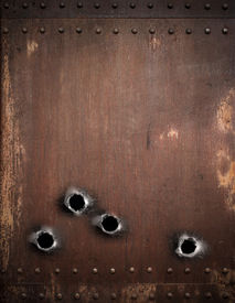 picture of gunshot  - old metal background with bullet holes - JPG
