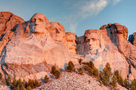 picture of mount rushmore national memorial  - Mount Rushmore National Memorial on a clear blue sunny morning during sunrise showing all four presidents faces in HDR - JPG
