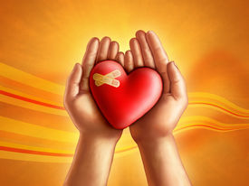stock photo of broken heart  - Hands holding a broken hearth care and compassion concept - JPG