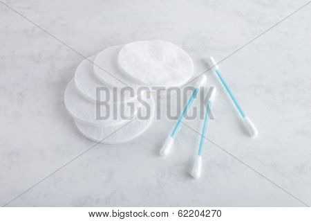 white cotton pads white and blue ear swabs