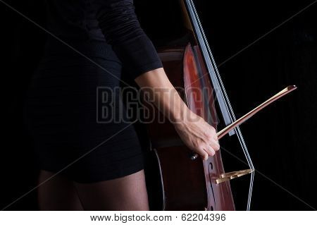 Beautiful Brunette Playing Cello With Selective Light In Black Dress