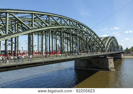 People Like To Walk Over The Beautiful Hohenzollern Bridge In Cologne On A Warm Summer Day