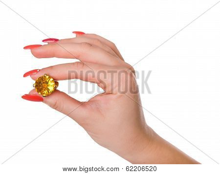 Woman's Hand Holding A Yellow Citrine Ring