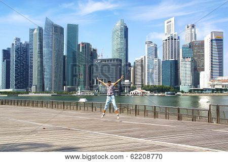 Tourist on the background of the downtown Singapore.