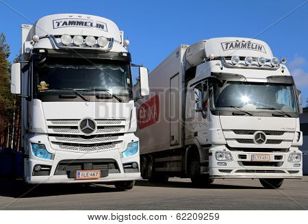 White Mercedes-benz Actros Trucks On A Yard