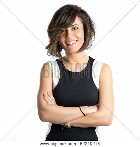 Pretty Woman With Hers Arms Crossed Over White Background