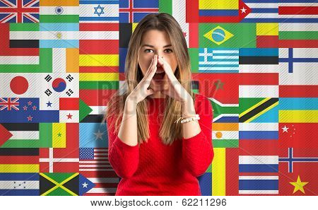 Young Girl Shouting Over Flags Background