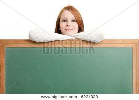 Cute Teen With Blank Chalkboard