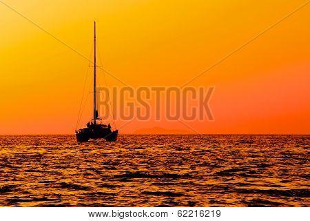 Catamaran Sailing At Sunset