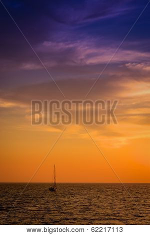 Ship Sailing At Dusk