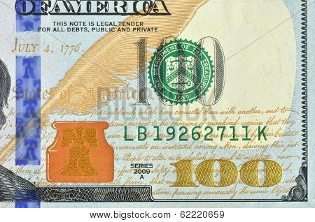 Hundred american dollars macro image. New look redesigned banknote. Front right down corner.
