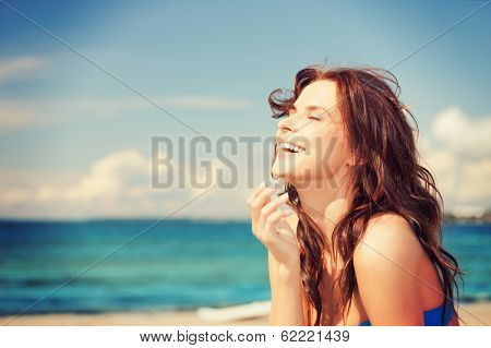 bright picture of laughing woman on the beach