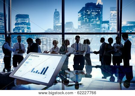 Group of business people discussing at city view reflected onto table with document.