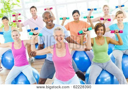 Group of Healthy People Exercising