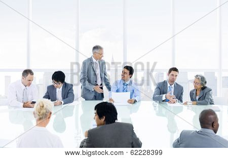 Group of Diverse  Business People Discussing at Meeting Table
