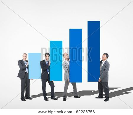 People Holding pillars of Growth Chart