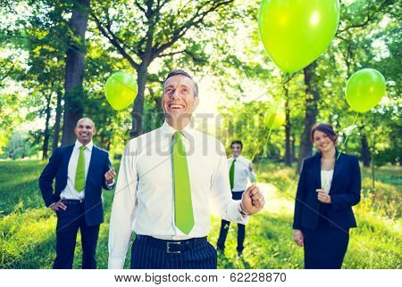 Environmentalist Business People Holding Green Balloons in Nature