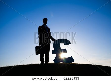 Businessman Holding Pound Currency Symbol