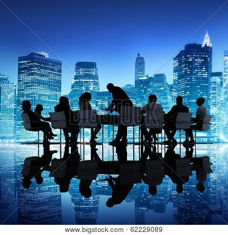 Group of Business People Meeting with City Skyline