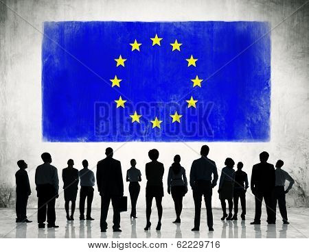 Silhouette of Business People Standing In Front of European Union Flag